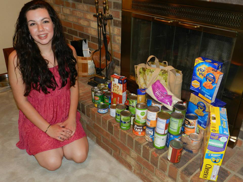 Kathryn Burress of Madeira with a few of her Sweet 16 birthday gifts for NEEDS.
